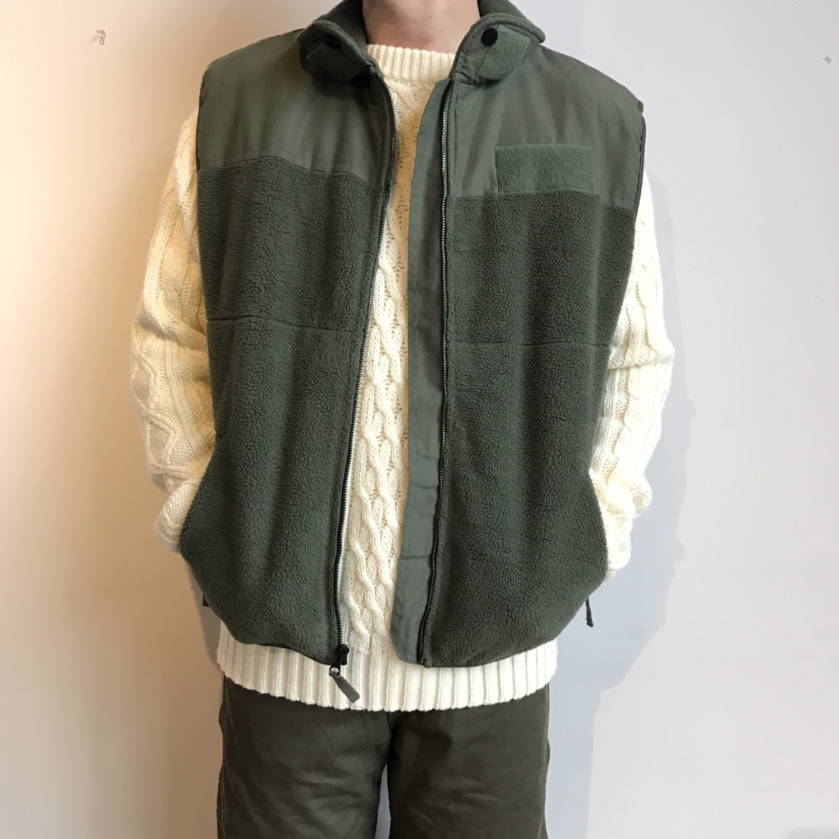 military fleece vest, cable sweater
